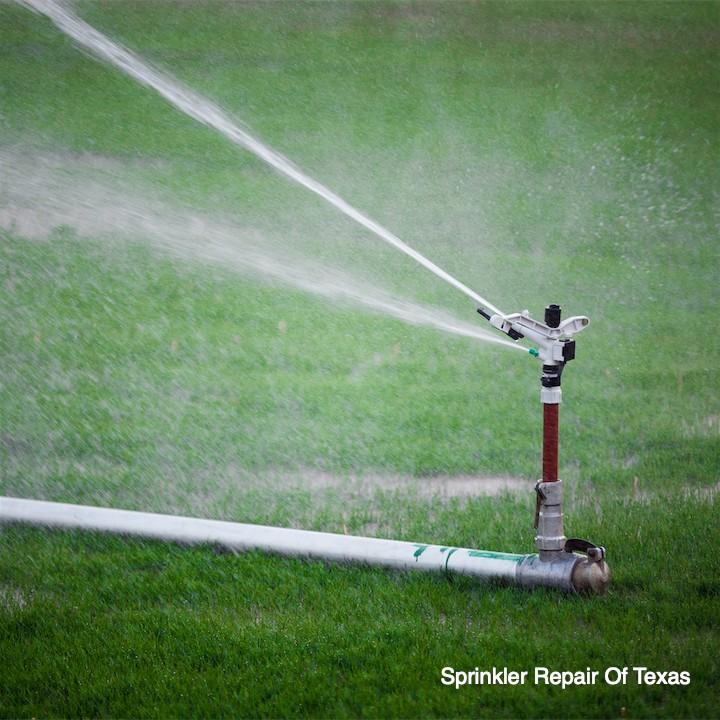 sprinkler-irrigating-field
